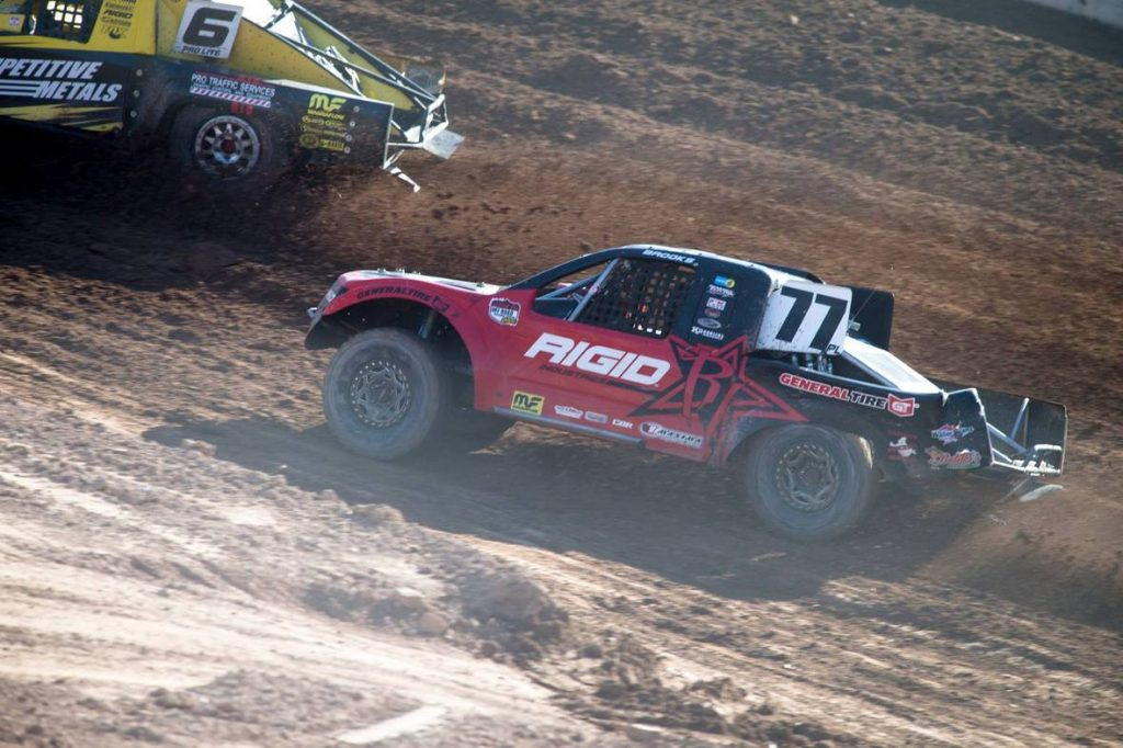 Jarrett on the back bumper of Brandon Arthur during Lucas Oil Off-Road Racing Round 15