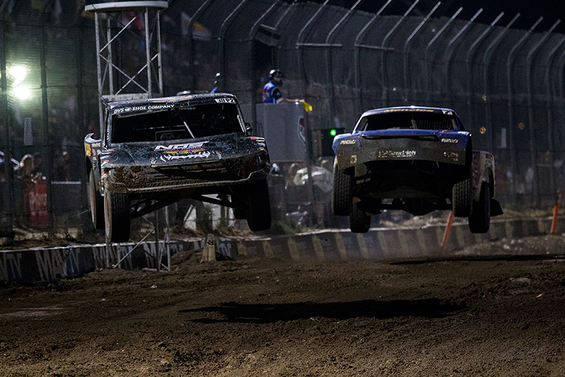 Brian Deegan getting around Bryce Menzies in the Lucas Oil Off-Road Racing event at Glen Helen