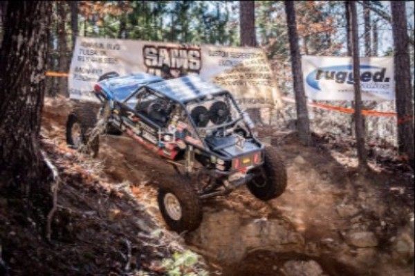 Derek West climbs as he competes in the Outlaw Racing Series