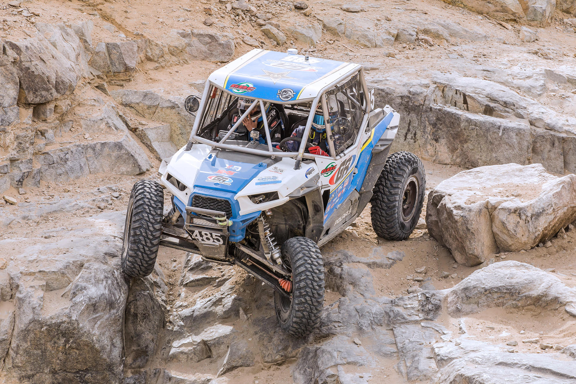 Jamie Pellegrino takes his RZR down the rocks at King of the Hammers