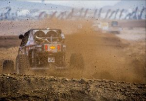 Derek West kicks up dirt at the start of King of the Hammers 2017