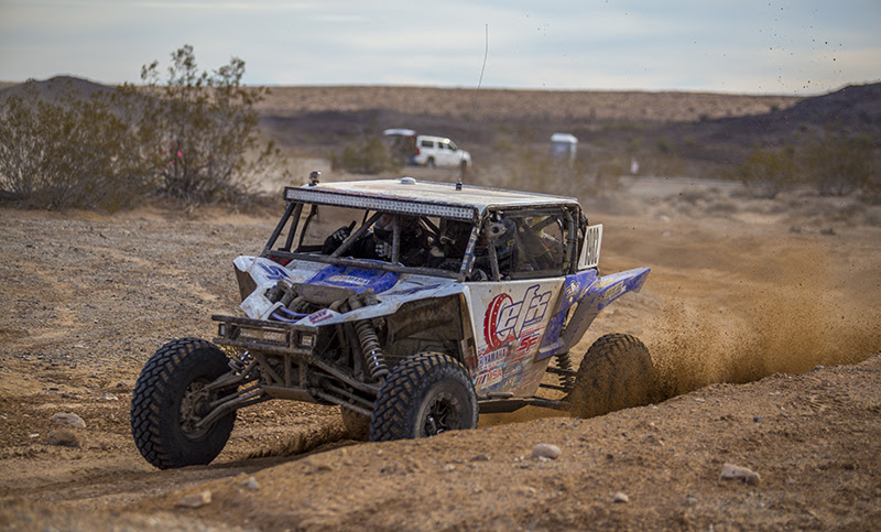 Jeremiah Staggs takes a turn while racing Parker 250