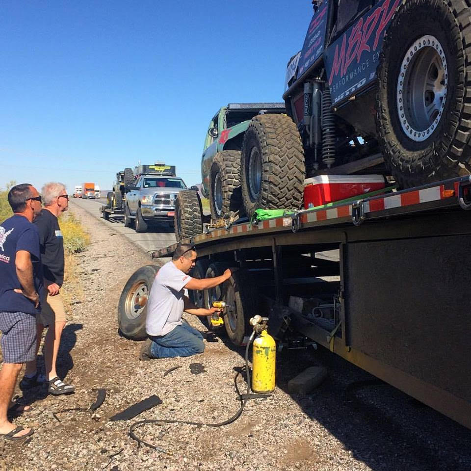 Helping fellow Ultra4 racers with a blowout on the way to Texas