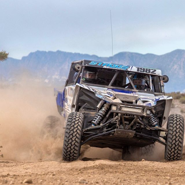 Jeremiah Staggs Racing kicks up dirt around a corner at Best in the Deserts Silver State 150
