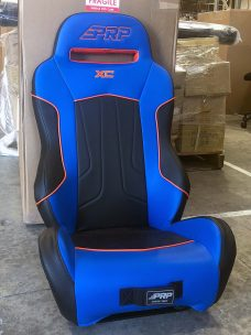 Pair of XC seats for the Yamaha Wolverine. Blue and black with orange piping.