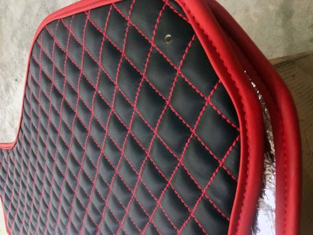 Pair of Slingshot insulated transmission tunnel pads in black and daytona red