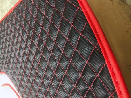 Pair of Slingshot insulated transmission tunnel pads in black and cf red