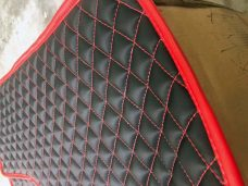 Pair of Slingshot insulated transmission tunnel pads in black and havasu red