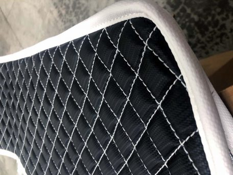 Pair of Slingshot insulated transmission tunnel pads in black and white close up