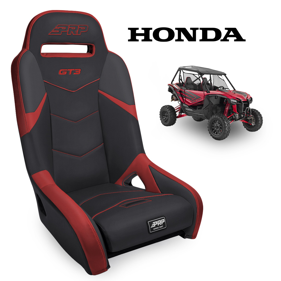 Black red GT3 seat with Honda Talon in the background