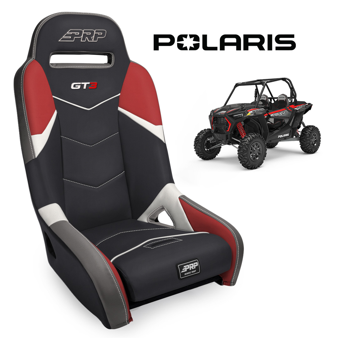Red white GT3 seat with Polaris RZR in background