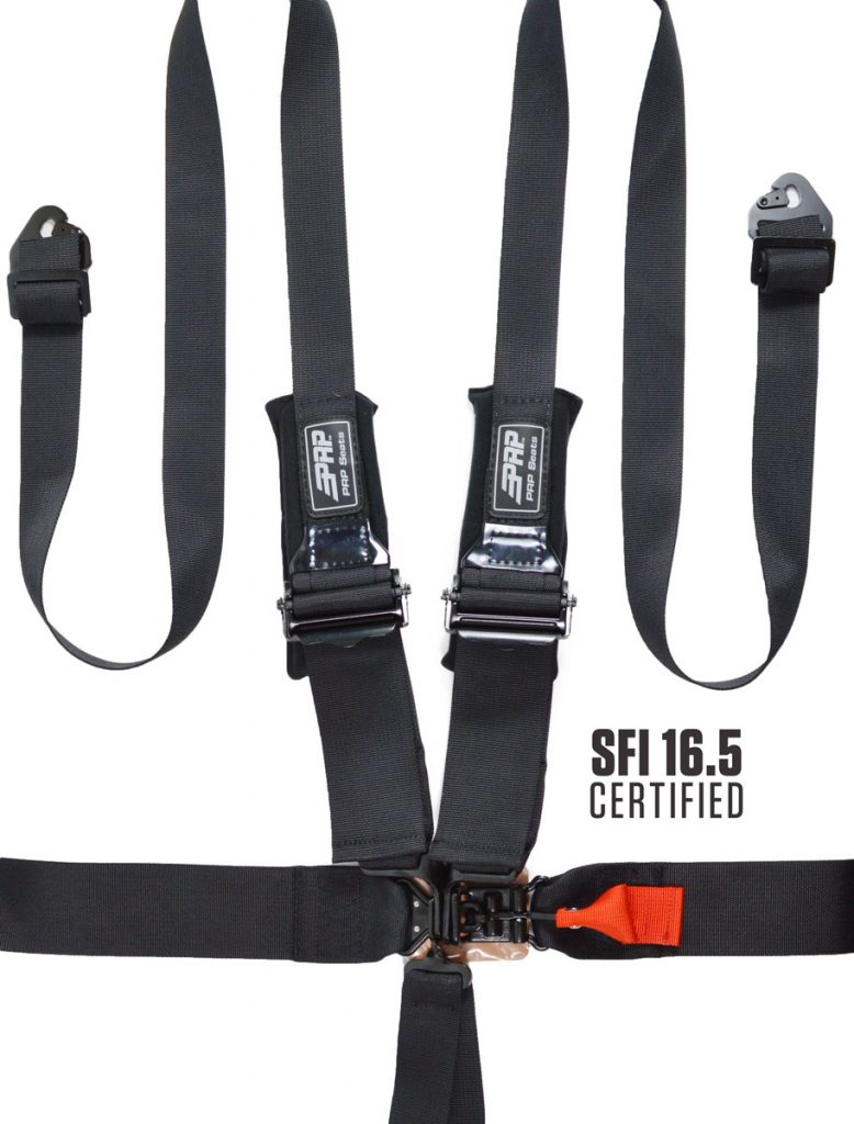 6 point harness with 3 inch lap belts, shortened shoulder pads and 2 inch shoulder belts to fit HANS devices.