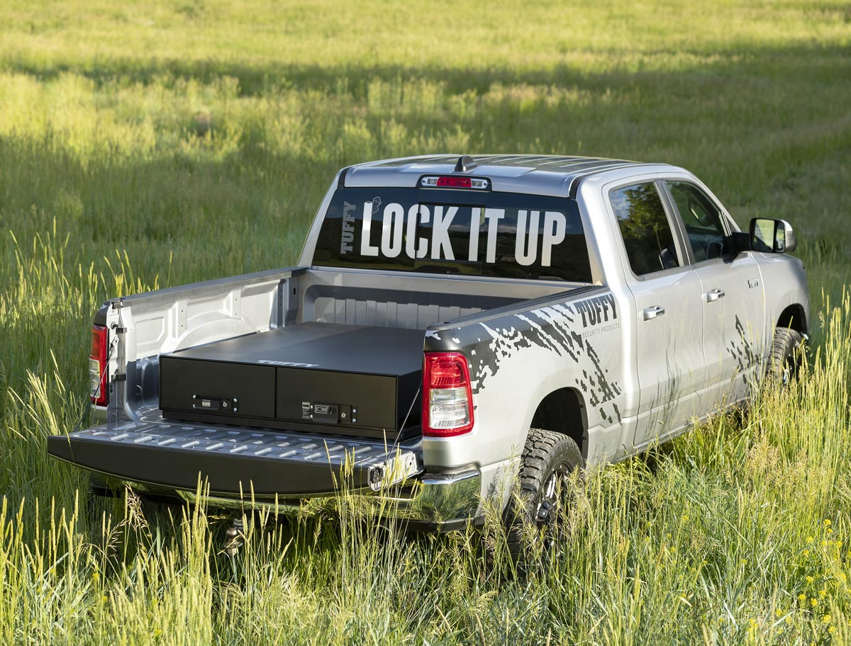 Tuffy security products with a truck in a long grass field showing lock boxes