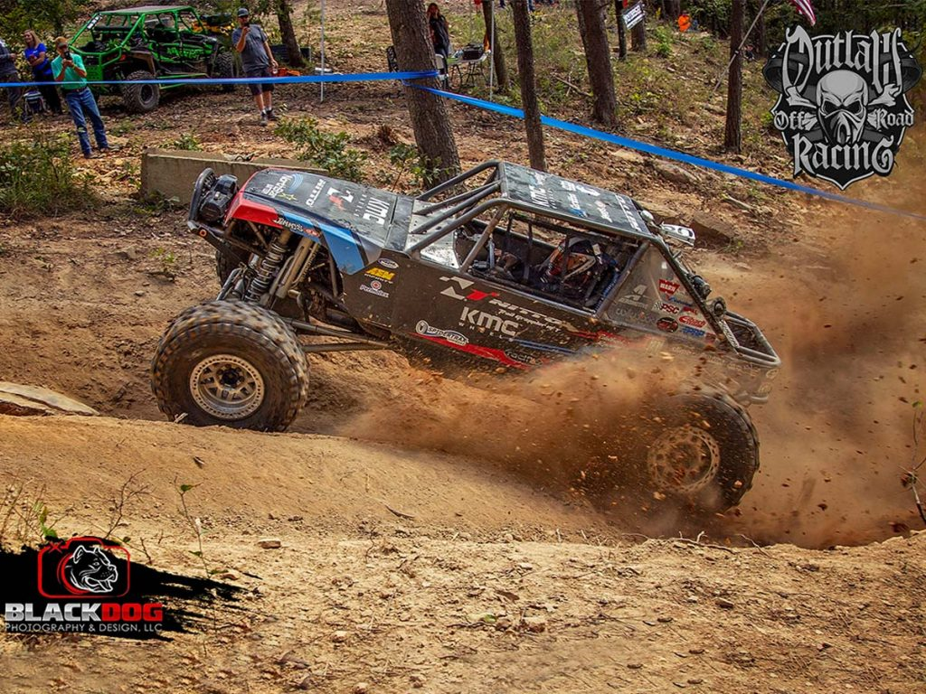 Buggy kicking up dirt and rock