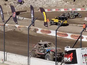 Buggy racing inside dirt race track