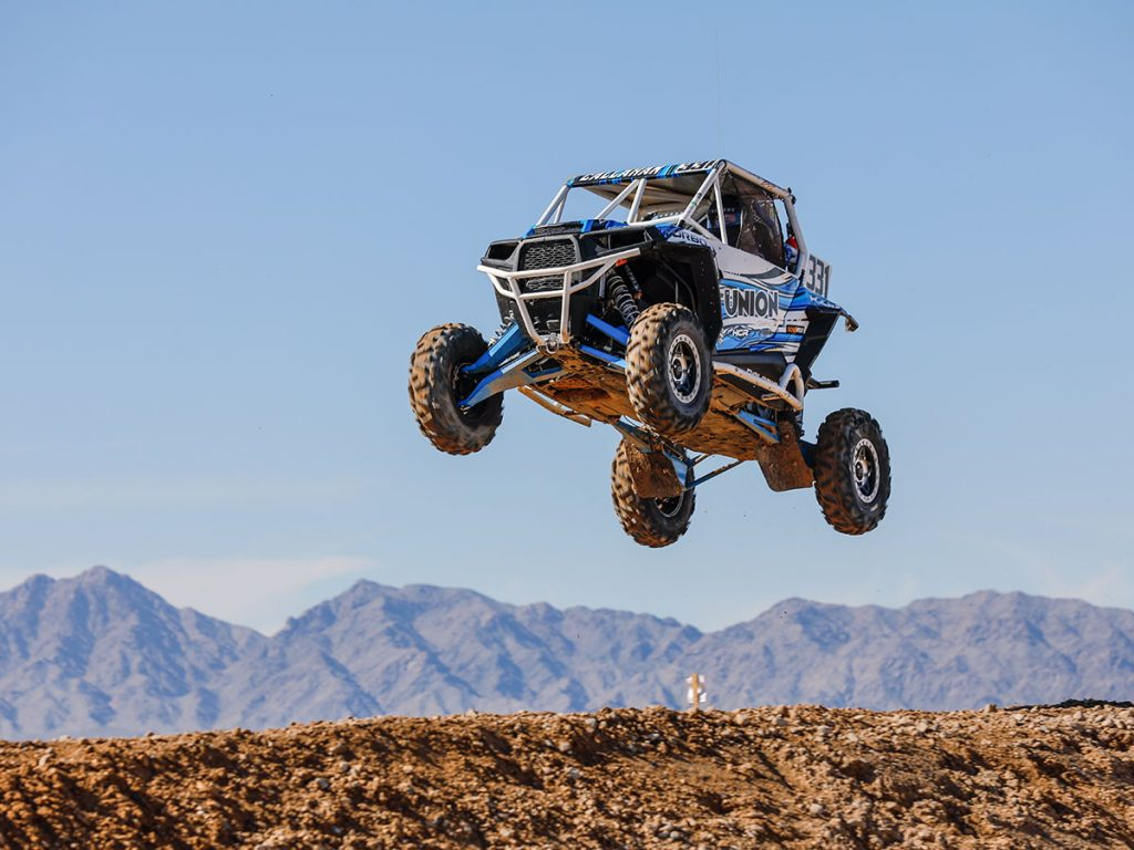 Callahan RZR Jumping with Mountain Range in Background
