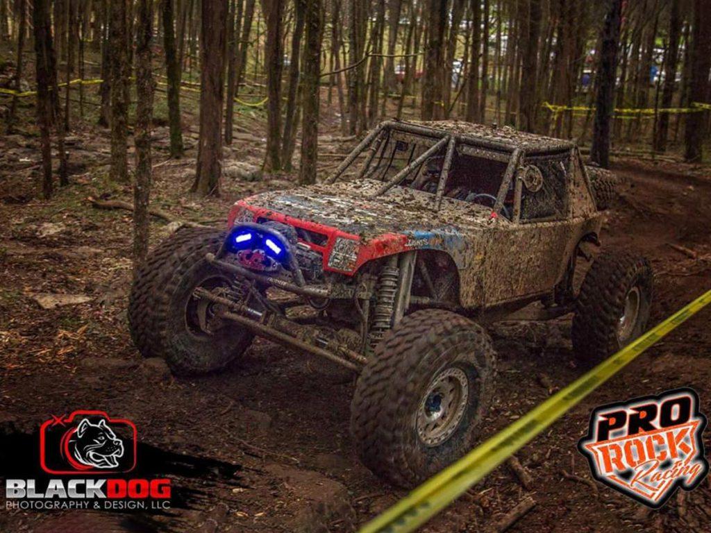 muddy buggy racing at dirt track